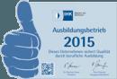 """Hier ist die Auszeichnung """"Ausbildungsbetrieb 2014"""", welcher von der IHK jedes Jahr verliehen wird dargestellt."""
