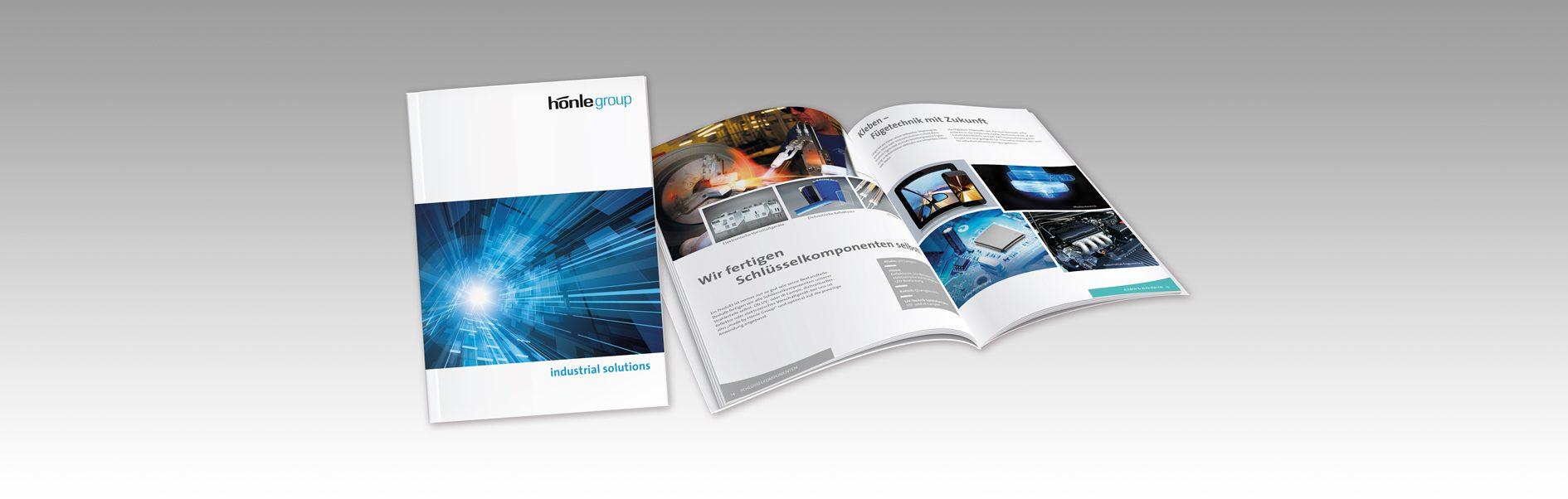 Hier ist der Titel und eine Doppelseite der 24-seitigen Unternehmensbroschüre abgebildet.